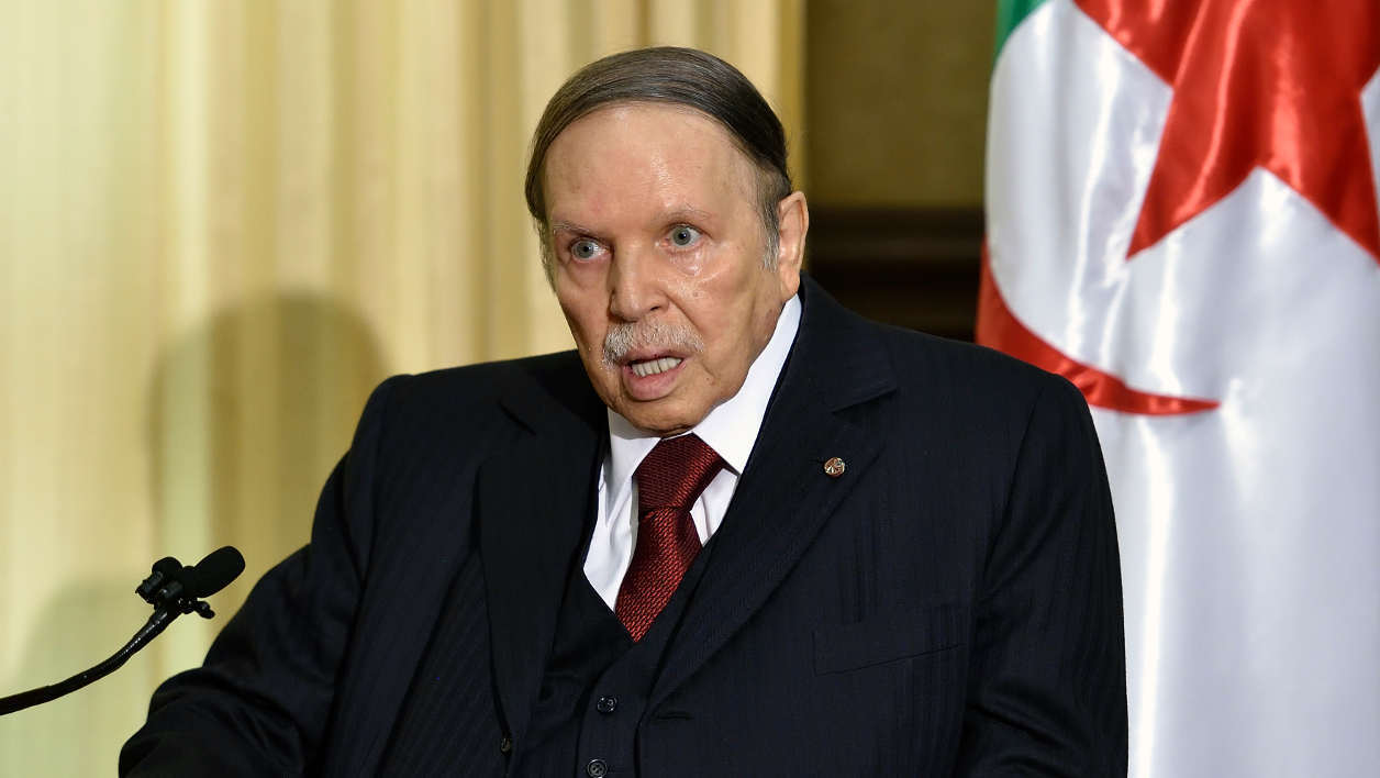 """(FILES) This file photo taken on April 10, 2016 shows Algerian President Abdelaziz Bouteflika meeting with the French prime minister at his residence in Zeralda, a suburb of the capital Algiers. Algeria's ailing President Bouteflika travelled to Geneva on April 24, 2016 for a """"routine medical check,"""" his office announced."""