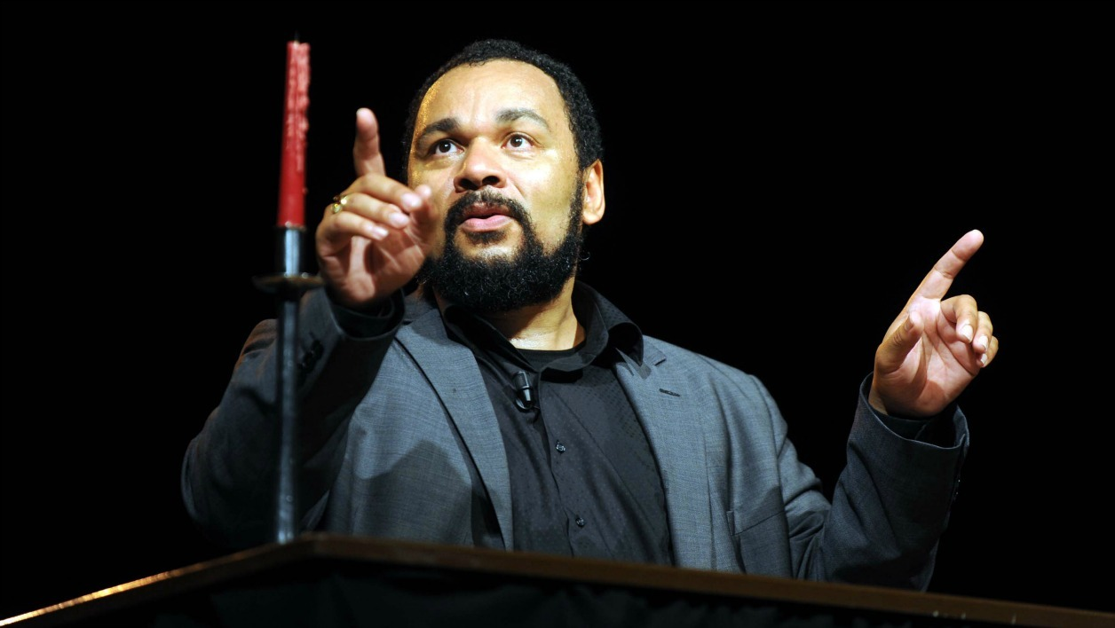 "French comedian Dieudonne M'bala M'bala acts during a performance of his new show ""Mahmoud"", at the Hilton hotel in Algiers, on July 21, 2011. AFP PHOTO / FAROUK BATICHE FAROUK BATICHE / AFP"