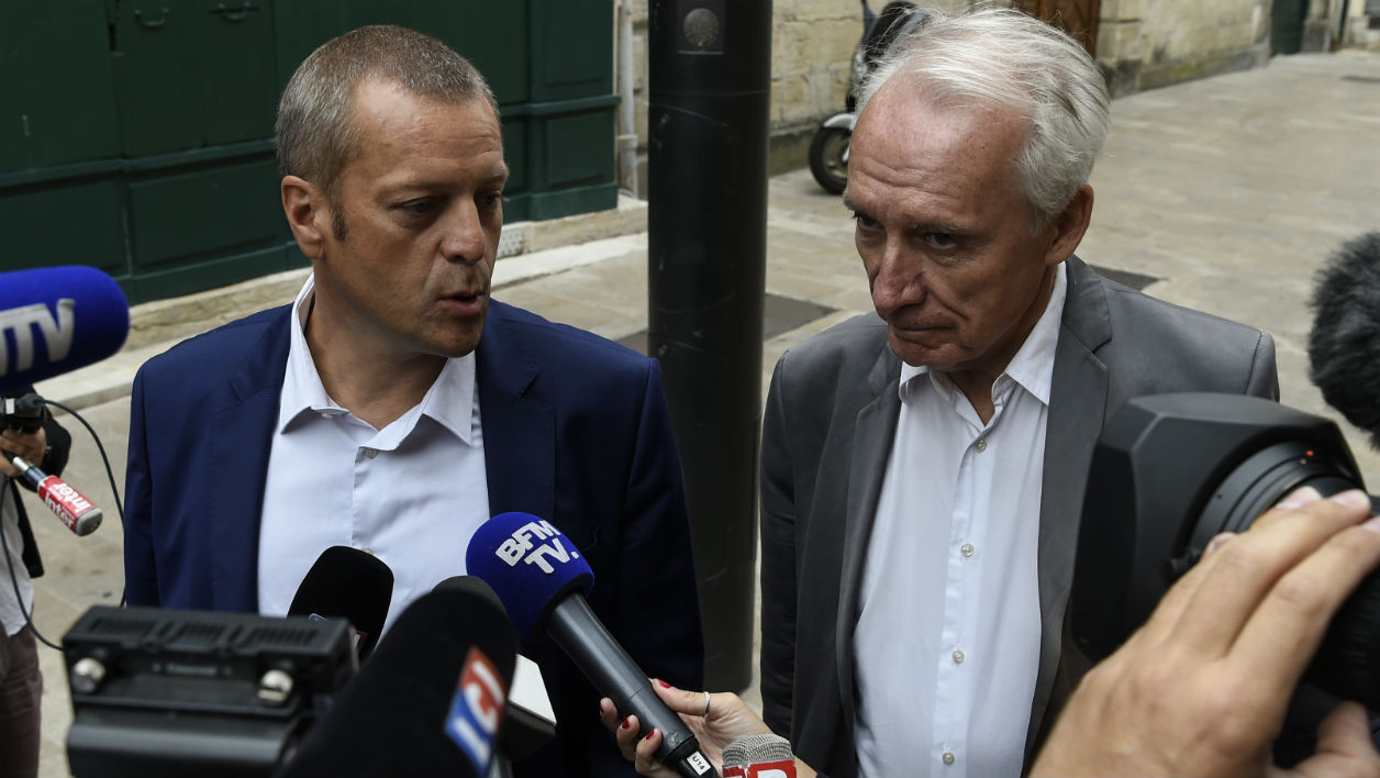 Key witness Murielle Bolle's French lawyers Jean-Paul Teissonniere (R) and Christophe Ballorin (L) arrive at the Court of Appeal in Dijon on August 4, 2017. PHILIPPE DESMAZES / AFP