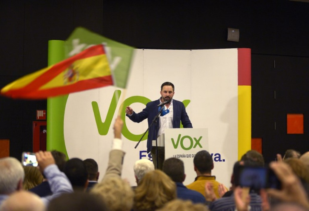 Santiago Abascal, leader of Spain's far-right party VOX, gives a speech during a campaign meeting ahead of regional elections in Andalusia, on November 26, 2018 in Granada. With a tough line on immigration and Catalan separatism, Spain's tiny far-right party VOX is starting to make waves and could win seats in a regional election for the first time in Andalusia on Sunday. While polls put the Socialists ahead in their traditional southern regional stronghold which they have ruled for the past 36 years, VOX appears on course to win up to five seats in the 109-seat Andalusian parliament in the snap polls.  CRISTINA QUICLER / AFP