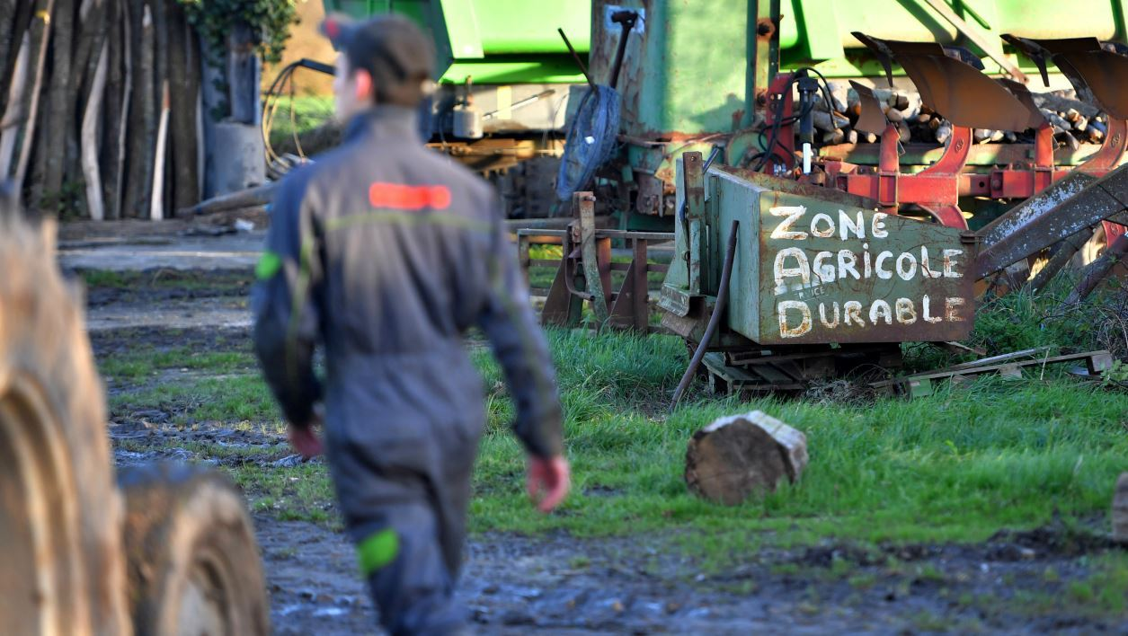 "A farmer works in La Vache rit, a farm in the ""Zad"" (zone a defendre, zone to defend) of Notre-Dame-des-Landes, on January 17, 2018 in Notre-Dame-des-Landes, outside Nantes."