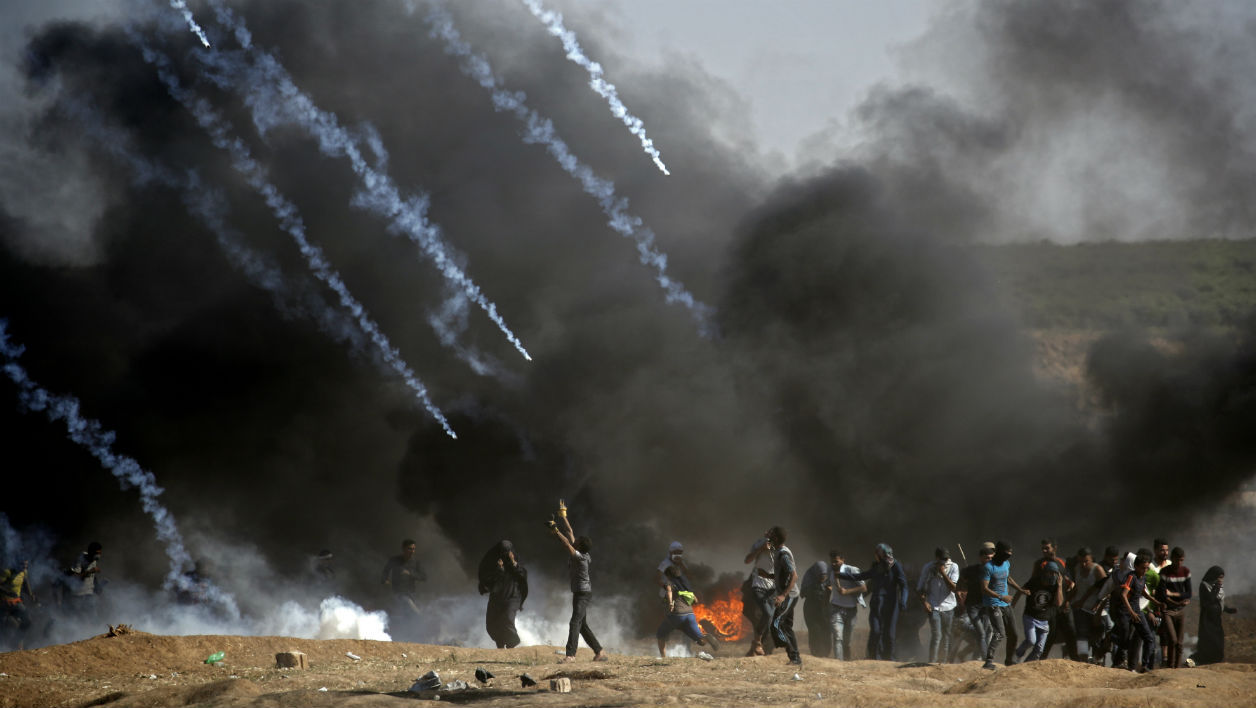 Tear gas is fired at protestors during clashes with Israeli forces near the border between the Gaza strip and Israel, east of Gaza City on May 14, 2018, following the the controversial move to Jerusalem of the United States embassy.
