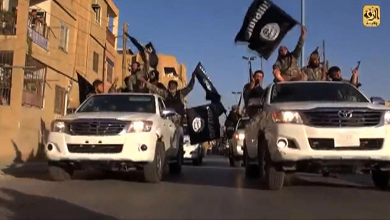 A screen grab taken from a video released on July 1, 2014, allegedly shows members of the IS (Islamic State) parading on a street in the northern rebel-held Syrian city of Raqa. AFP PHOTO / HO / WELAYAT RAQA jihad daeshj etat islamique jihadiste jihadistes
