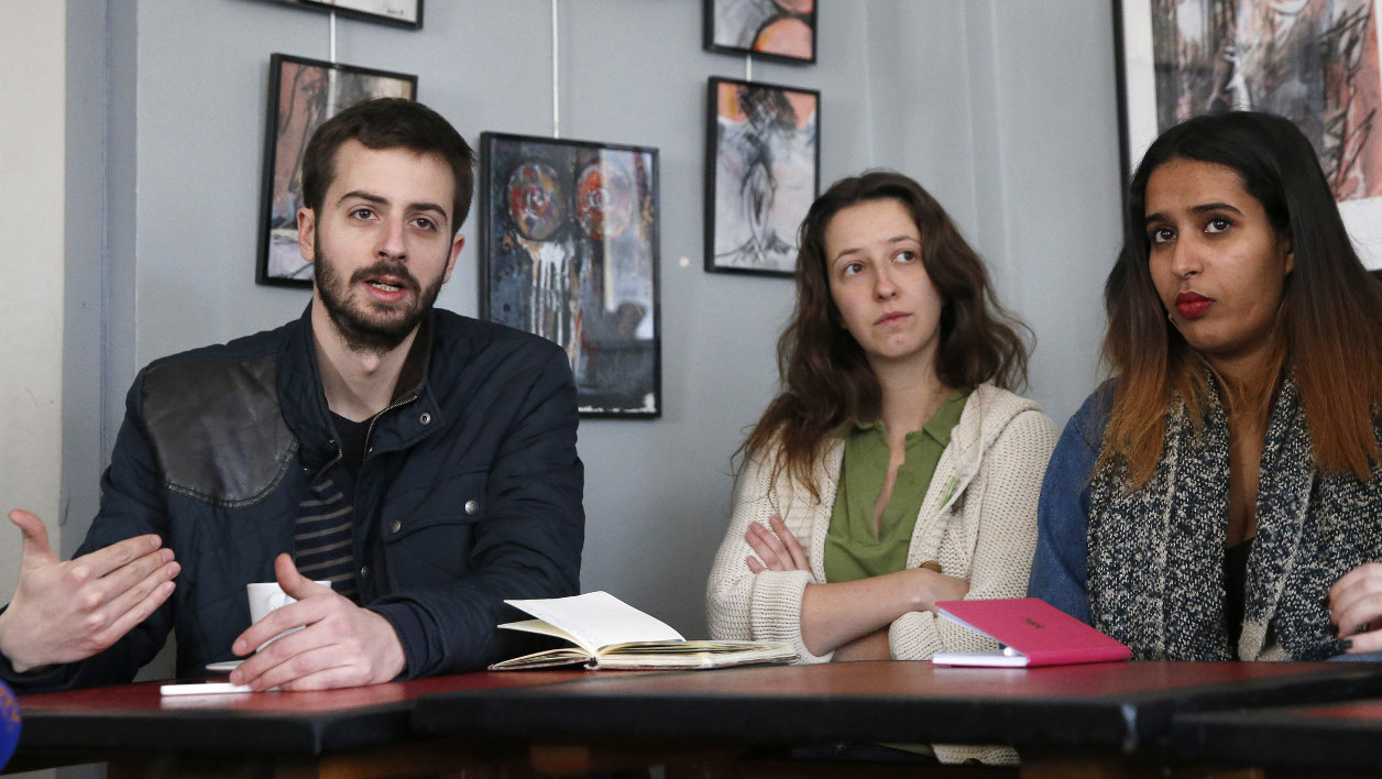 (LtoR) French university student union UNEF president William Martinet, Lea Caillere-Falgueyrac, member of the Jeunes Ecolos organisation, and Samia Moktar, member of the UNL union, give a press conference on March 15, 2016 in Paris, to call for a demonstration against proposed labour law reforms.  PATRICK KOVARIK / AFP