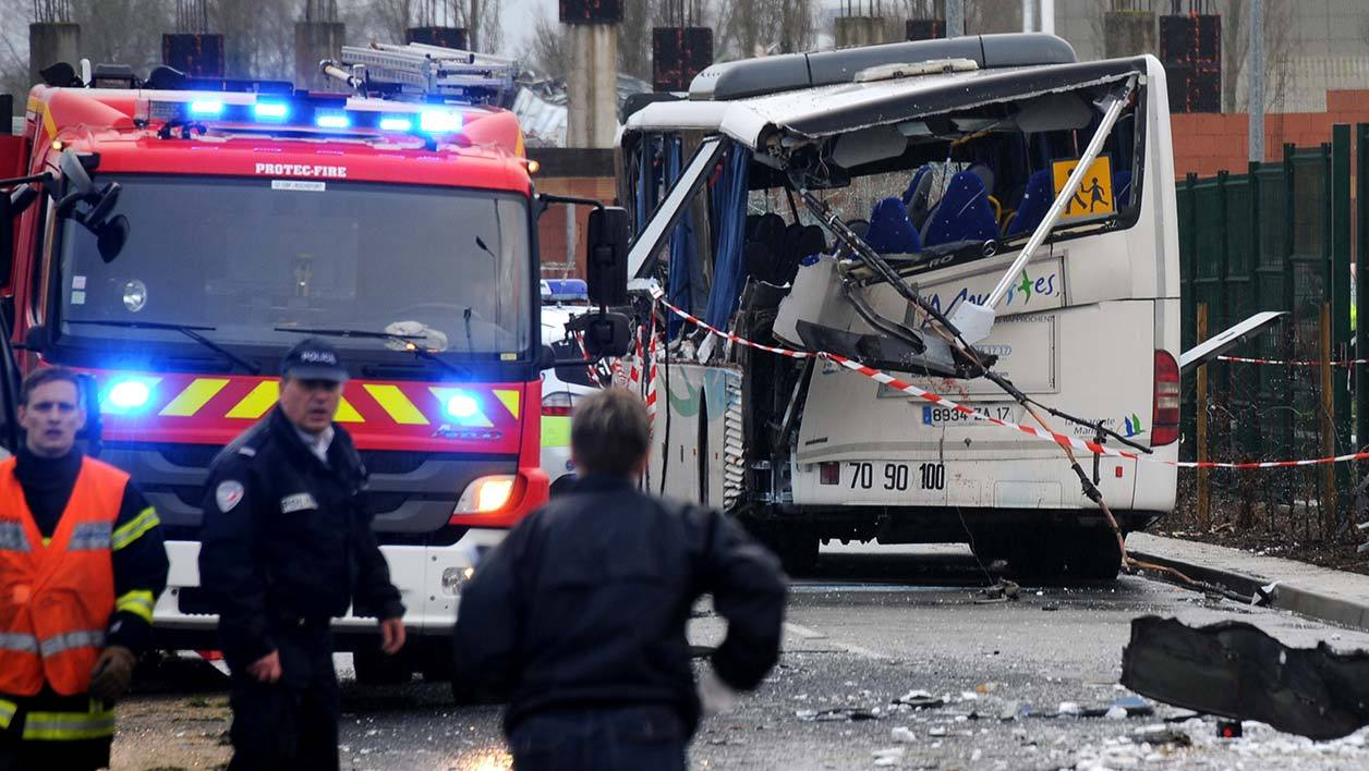 French police work near the wreckage of a school minibus after it crashed into a truck near Rochefort on February 11, 2016, killing at least six children, police said, a day after another road accident involving a school bus left two youngsters dead. The head-on smash with a lorry carrying rubble came around 7:15 am (0615 GMT) near Rochefort in the western Charente-Maritime region.