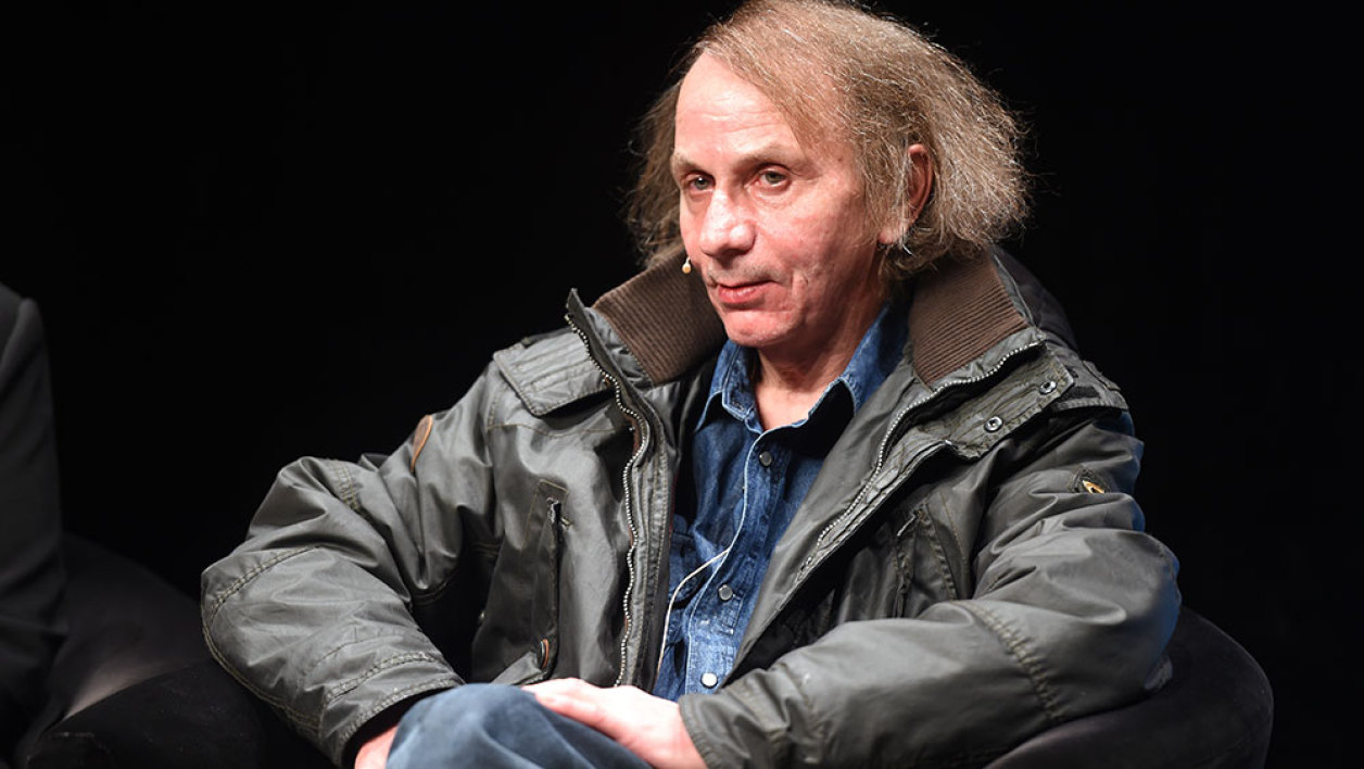 "French author Michel Houellebecq presents his new book ""Soumission"" (""Submission"") before a reading as part of the LitCologne literature festival on January 19, 2015 at Schauspielhaus in Cologne, Germany. ""Soumission"", the sixth novel by Houellebecq -- one of France's best-known and most widely translated authors -- deals with a subject matter very likely to stir debate in a France, which is undergoing political and economic turmoil."