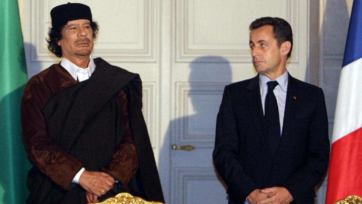 "In this file photograph taken on December 10, 2007, then French President Nicolas Sarkozy (R) and Libyan leader Moamer Kadhafi pose during the signature of 10 billion euros of trade contracts between the two countries at the Elysee Palace in Paris. France signed an agreement to supply ""one or more nuclear reactors"" to Libya."