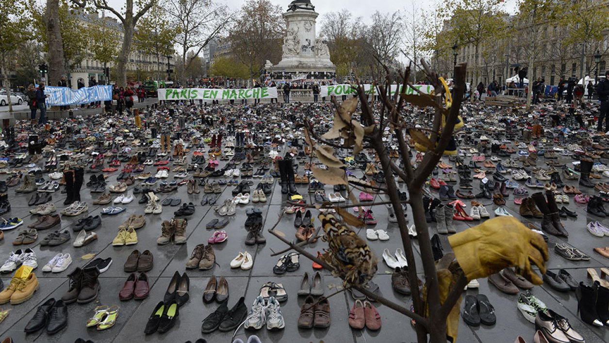 "The Place de la Republique is covered in hundreds of pairs of shoes on November 29, 2015 in downtown Paris, as part of a symbolic and peaceful rally called by the NGO Avaaz ""Paris sets off for climate"" within the UN conference on climate change COP21, as an attempt to get round the French authorities' ban on public gatherings. Paris has extended a ban on public gatherings introduced after the terror attacks in the French capital until November 30, the start of UN climate talks, where some 150 leaders will be tasked with reaching the first truly universal climate pact."