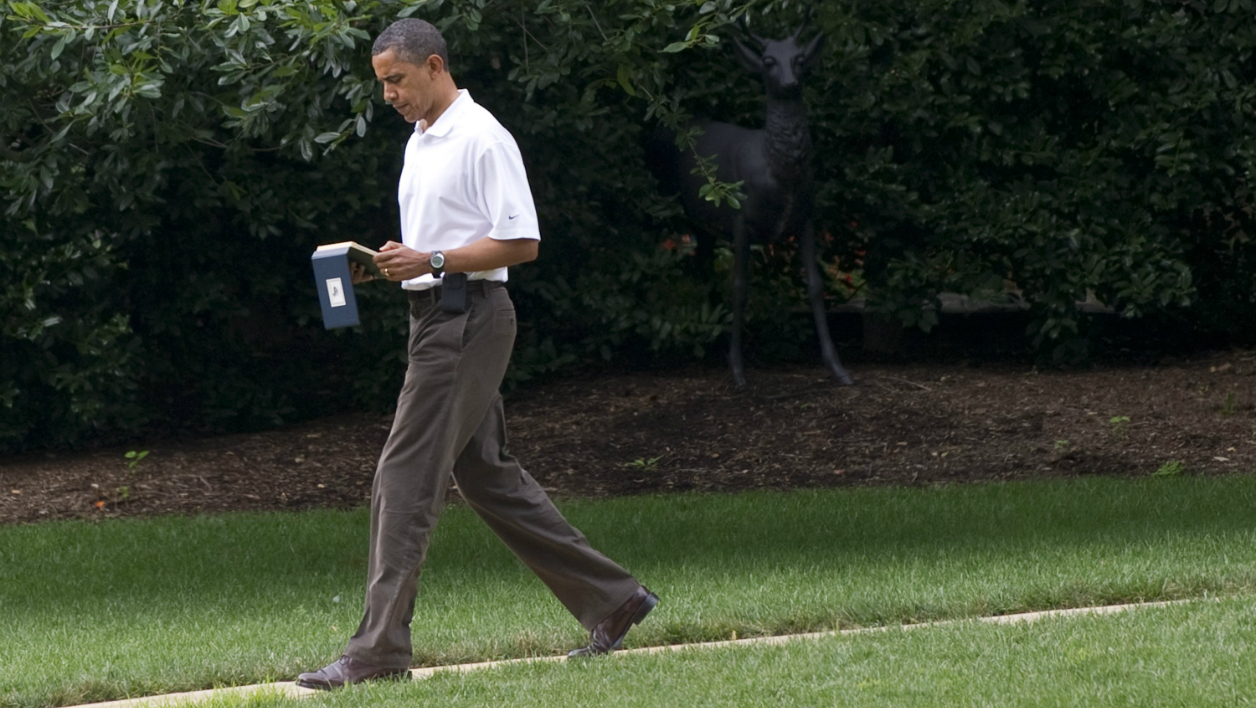 US President Barack Obama carries a computer tablet as he walks from the Oval Office to a waiting motorcade on the South Lawn of the White House in Washington, DC, on August 13, 2011, prior to playing golf at Andrews Air Force Base in Maryland