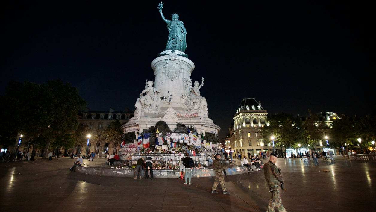 French soldiers patrol near the place de la Republique's monument in Paris, on July 26, 2016 after a priest was killed in the Normandy city of Saint-Etienne-du-Rouvray in the latest of a string of attacks against Western targets claimed by or blamed on the Islamic State jihadist group.  GEOFFROY VAN DER HASSELT / AFP