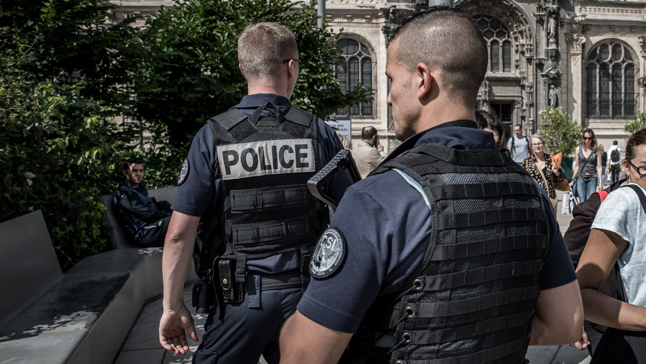 "French police officers of the CSI unit (Compagnie de securisation et d'intervention) control people in the streets of Paris on June 30, 2016. ""We are the first ramparts"" summarizes Sebastian, Brigadier Alpha 22 Team. Under the canopy of the Forum des Halles in Paris, the police of the CSI75 are more vigilant, especially with the summers sales and the EURO 2016. In charge everyday of the security of Paris, the CSI75 have to work on several field, from the security during protests against the labor law to the first moments of the attacks at the Bataclan in November 2015. PHILIPPE LOPEZ / AFP"