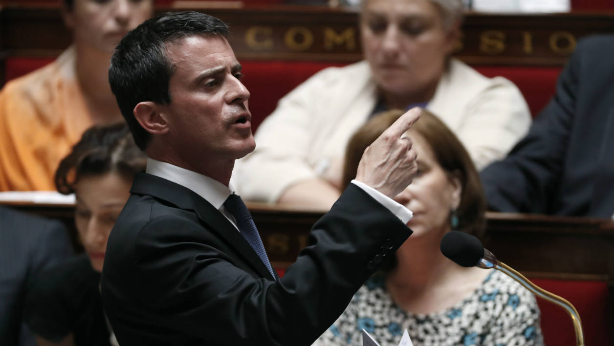 French Prime minister Manuel Valls (C) speaks during a session of questions to the government at the National Assembly in Paris on July 20, 2016.