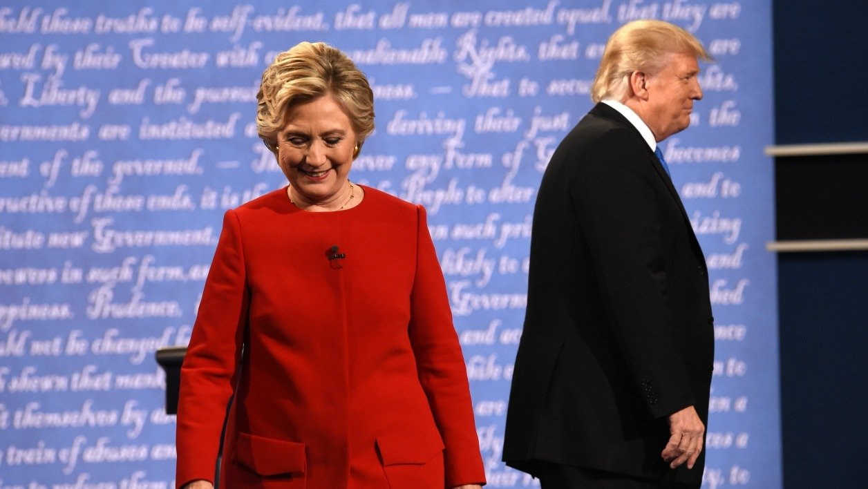 Democratic nominee Hillary Clinton (L) and Republican nominee Donald Trump leave the stage after the first presidential debate at Hofstra University in Hempstead, New York on September 26, 2016.  Timothy A. CLARY / AFP