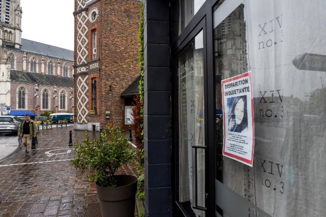 A search notice for Angelique, a 13-year-old teenager, is displayed on the window of a store on April 29, 2018 in the French northern city of Wambrechies, near Lille. The body of Angelique, who had disappeared since April 25, was found in the night from April 28 to April 29 in the countryside in Quesnoy-sur-Deule, northern France, and a man was arrested, according to police on April 29.