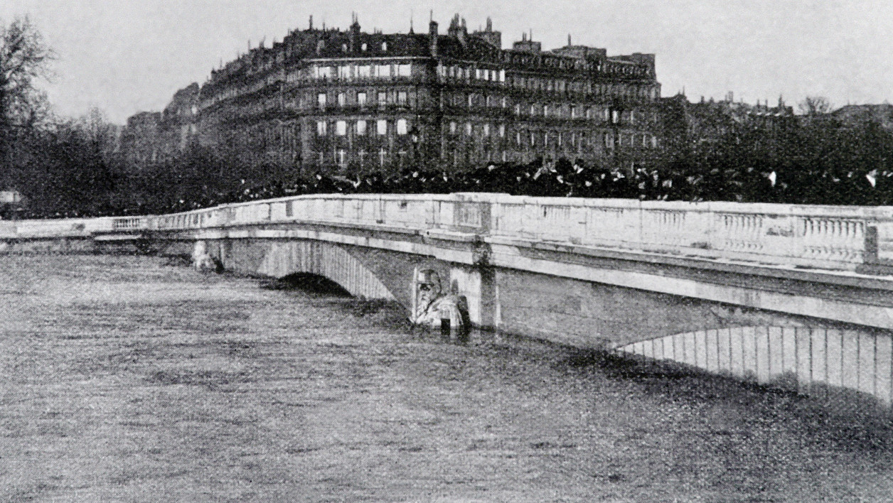 """This combination made on June 3, 2016 shows a picture (up) of the statue of the Zouave soldier (L) at the Alma bridge in Paris taken on January 27, 1910 during the """"Great Flood"""" and the same renewed bridge with the Zouave statue (taken from the other side of the river bank) moved in center taken on June 3, 2016 (bottom). The rain-swollen river Seine in Paris reached its highest level in three decades on June 3, 2016, spilling its banks and prompting the Louvre museum to shut its doors and evacuate artworks in its basement. Parisians were urged to avoid the banks of the river which was expected to reach a peak of six metres (19 feet), while deadly floods continued to wreak havoc elsewhere in France and Germany.  JOEL SAGET / AFP"""