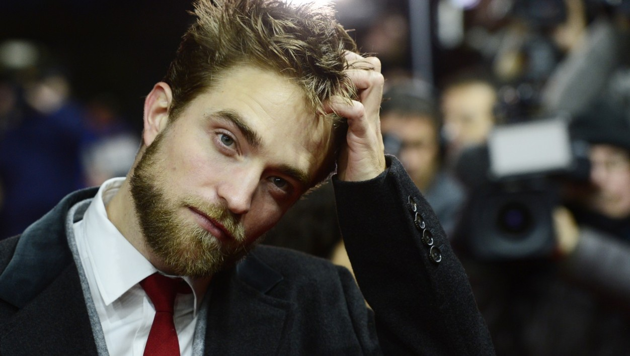 """British actor Robert Pattinson poses for photographers upon arrival for the screening of the film """"Life"""" presented as Berlinale Special at the 65th Berlin International Film Festival Berlinale in Berlin, on February 9, 2015."""