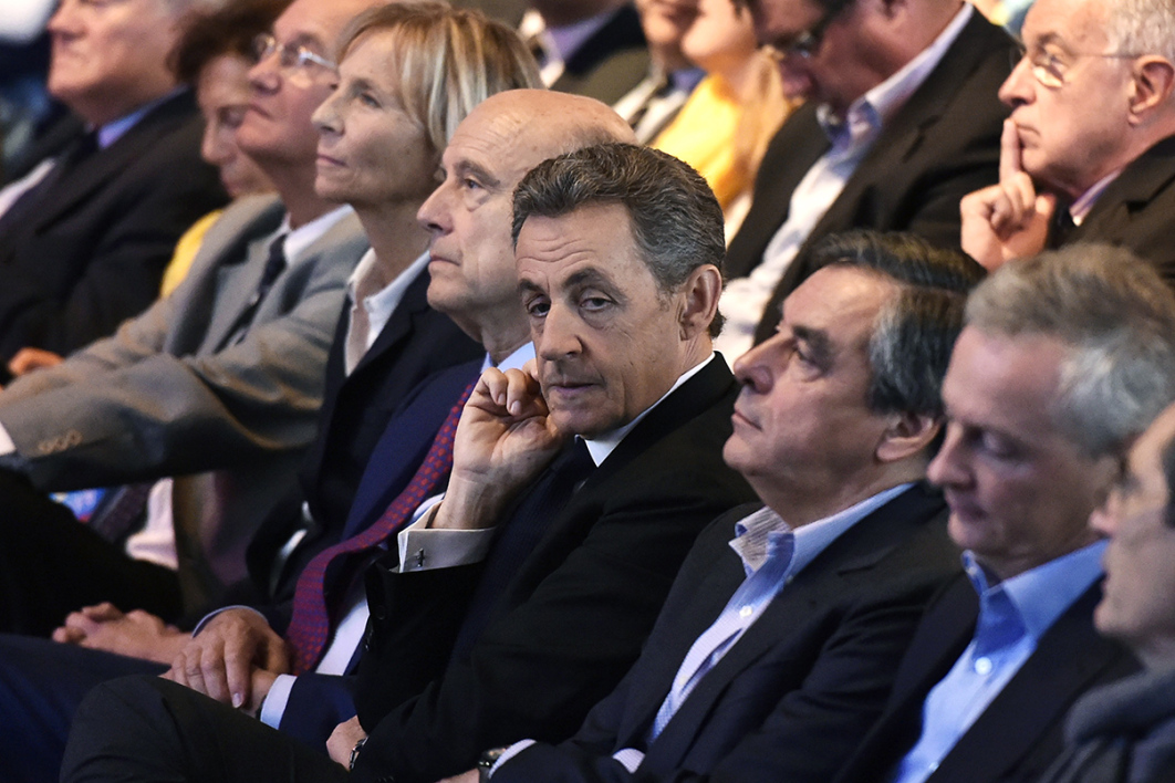 Head of French right-wing party Les Republicains and former President Nicolas Sarkozy (3rd R) looks on as he sits next to Les Republicains' party member and Mayor of Bordeaux Alain Juppe (4th R), Les Republicains party member and Former French Prime Minister Francois Fillon (2nd R), UDI-MoDem's chief candidate for the Ile de France region and MoDem vice-President Marielle de Sarnez (5th