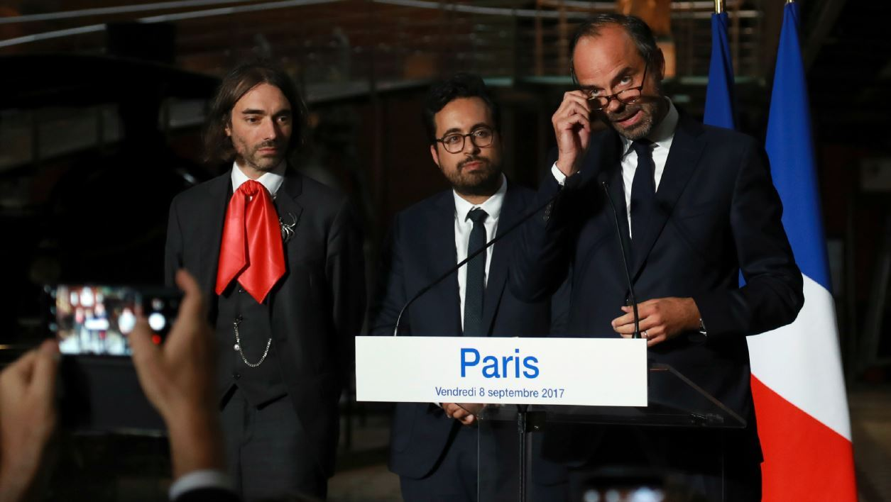 """French Prime minister Edouard Philippe (R) delivers a speech on France's """"national strategy for artificial intelligence"""" next to French mathematician and MP Cedric Villani (L) and French Junior Minister for the Digital Sector Mounir Mahjoubi (R) , on September 8, 2017 in Paris.  JACQUES DEMARTHON / AFP"""
