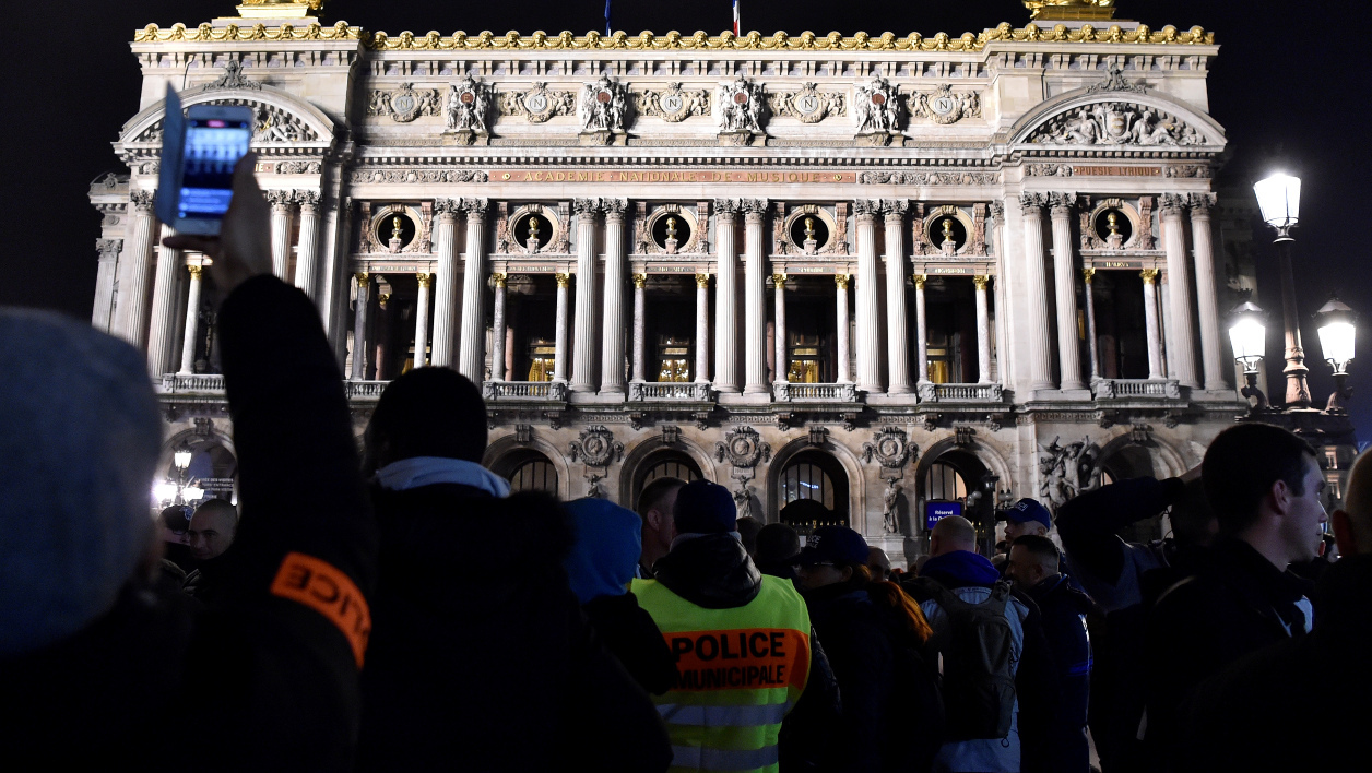 "French police officers gather in front of the Opera Garnier in Paris, during a protest against mounting attacks on officers on October 24, 2016. France's Interior Minister Bernard Cazeneuve on October 24 attended a meeting in Rouen between the head of police Jean-Marc Falcone, unions and police officers, ""to understand their discomfort,"" on the eighth day of their of movement, noted AFP. The frustrated officers want reinforcements and stiffer penalties after a string of attacks on law enforcement, as the issue of safety feeds into France's looming presidential race.  ALAIN JOCARD / AFP"