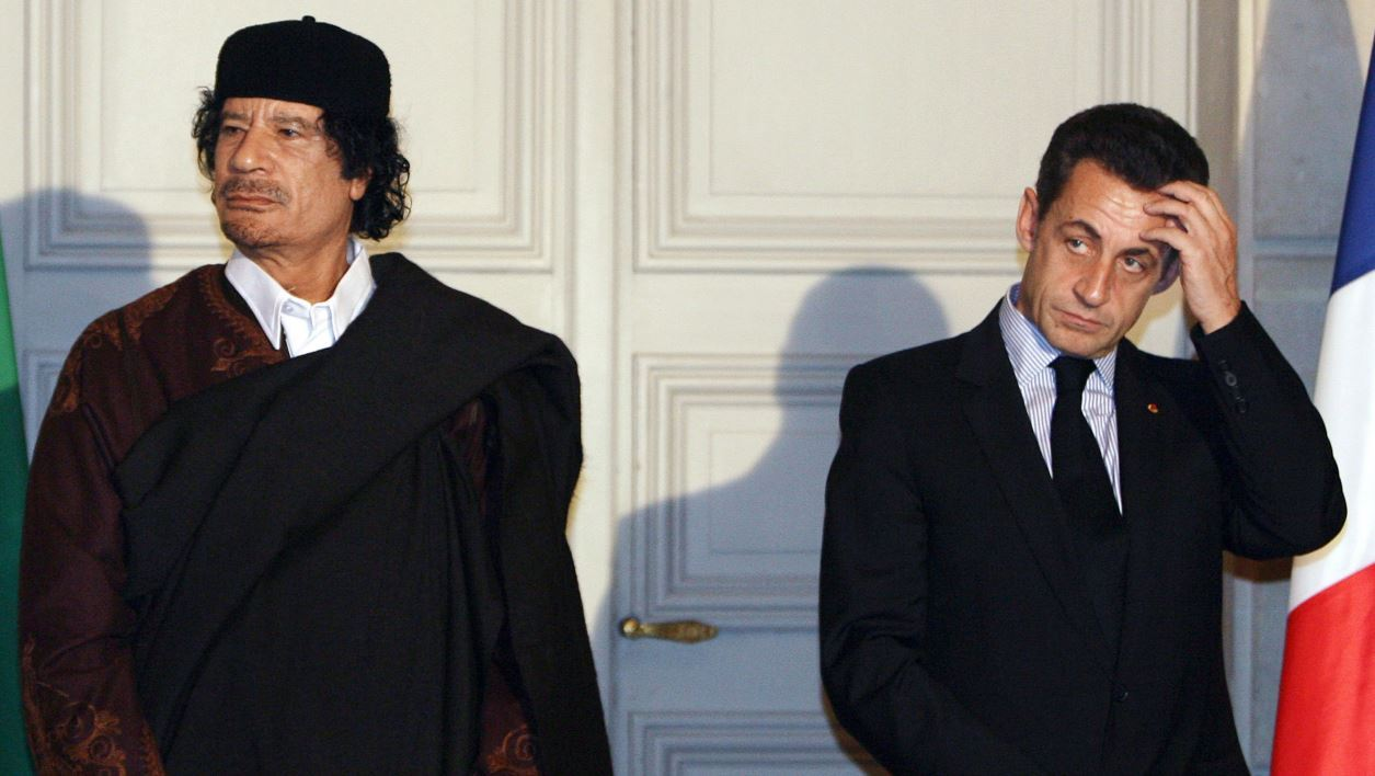 In this file photo taken on December 10, 2007 French President Nicolas Sarkozy (R) and Libyan leader Moamer Kadhafi pose during the signature of 10 billion euros of trade contracts between the two countries at the Elysee Palace in Paris.