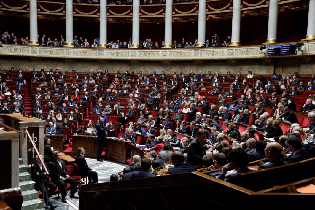 French members of Parliament observe a minute of silence in tribute to victims of the shooting at a Christmas market in Strasbourg as they attend a session of questions to the government at the National Assembly in Paris on December 12, 2018. French government has raised the security alert level for terrorism to its highest, reinforcing border controls and patrols around all Christmas markets across France. Hundreds of police and anti-terror forces hunted on December 12, 2018 for a gunman who shot dead several people and wounded a dozen at a Christmas market in Strasbourg, with the suspect known to police and thought to be an religious extremist.  Bertrand GUAY / AFP