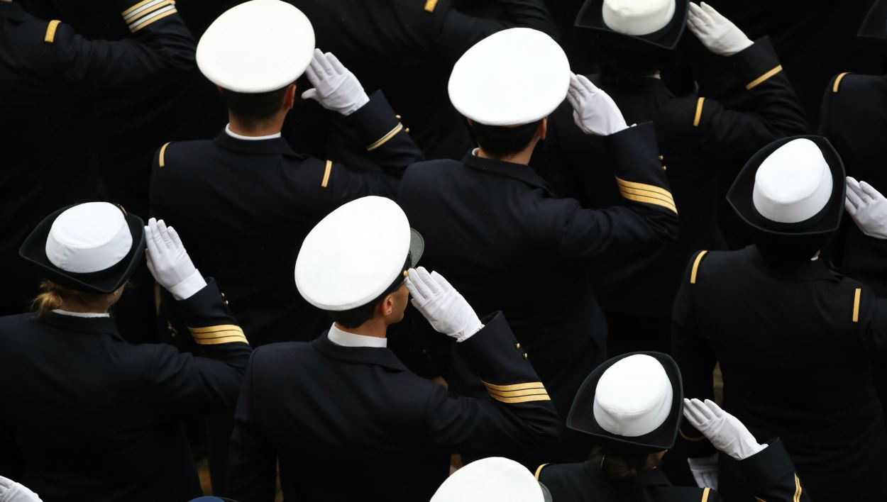 French military personnel salute during a military ceremony at the Hotel des Invalides on November 27, 2017 in Paris.  JACQUES DEMARTHON / AFP