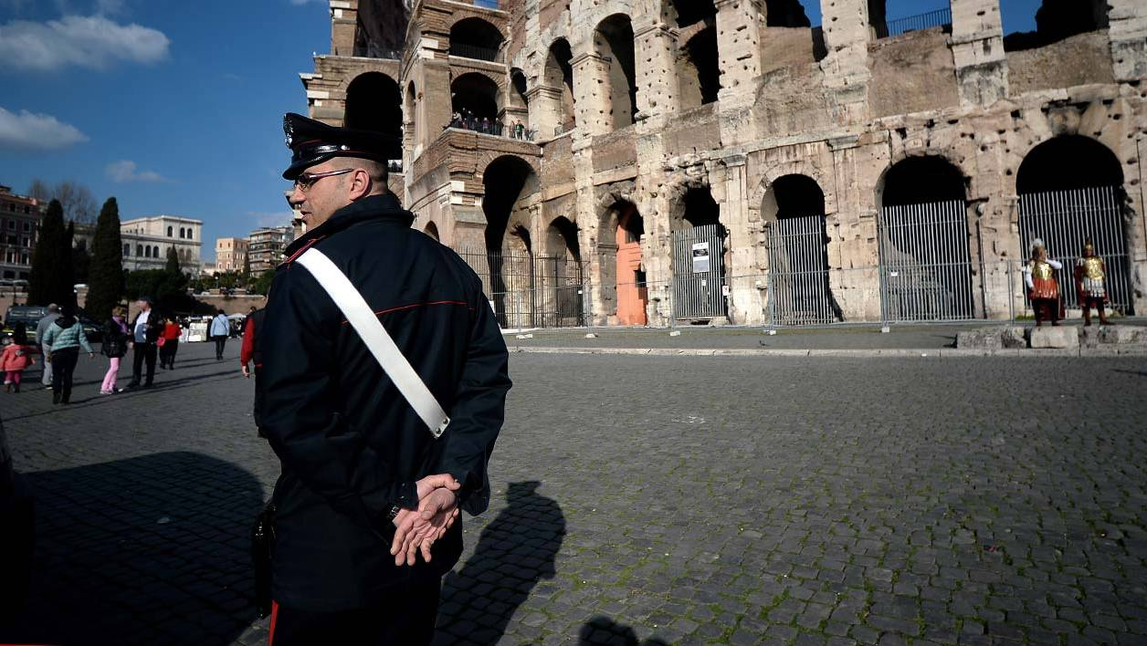 A carabinieri patrols near the Colosseum on February 19, 2015 in Rome. Security at the Vatican and across Italy has been stepped up because of a perceived heightened risk of attacks by Islamist militants, officials said yesterday. A day after the Italian cabinet approved new security measures because of fears of a terrorist spillover from the chaos engulfing Libya, the head of the Vatican's Swiss Guard confirmed additional precautions had been taken to ensure the safety of Pope Francis. AFP PHOTO / FILIPPO MONTEFORTE  FILIPPO MONTEFORTE / AFP