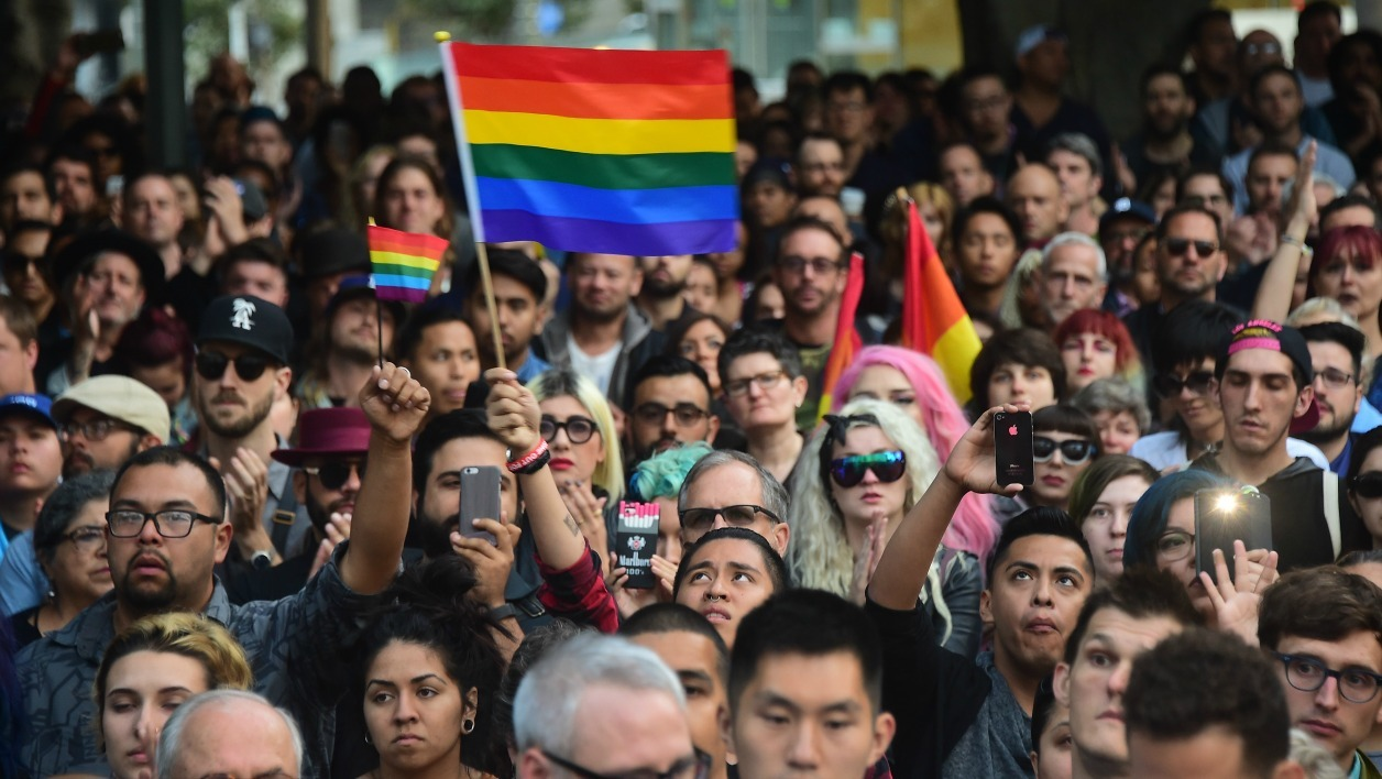 Hundreds attend a rally and vigil for the shootings in Orlando at Los Angeles City Hall on June 13, 2016 in Los Angeles, California organized by the Los Angeles LGBT Center. The American gunman who launched a murderous assault on a gay nightclub in Orlando was radicalized by Islamist propaganda, officials said Monday, as they grappled with the worst terror attack on US soil since 9/11.