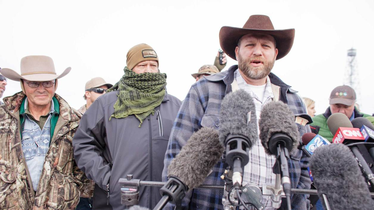 Ammon Bundy(C), leader of a group of armed anti-government protesters speaks to the media as other members look on at the Malheur National Wildlife Refuge near Burns, Oregon January 4, 2016. The FBI on January 4 sought a peaceful end to the occupation by armed anti-government militia members at a US federal wildlife reserve in rural Oregon, as the standoff entered its third day. The loose-knit band of farmers, ranchers and survivalists -- whose action was sparked by the jailing of two ranchers for arson -- said they would not rule out violence if authorities stormed the site, although federal officials said they hope to avoid bloodshed.