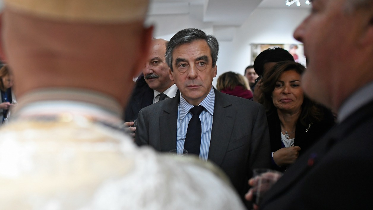 French presidential election candidate for the right-wing Les Republicains (LR) party Francois Fillon meets with Brie cheese producers at the tourist office on February 27, 2017 in Meaux, near Paris.  Lionel BONAVENTURE / AFP