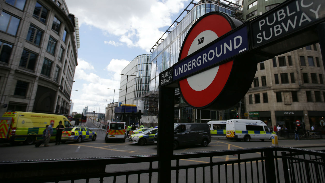 Police vehicles block the acccess to London bridge, pictured from Monument underground station, in London on June 4, 2017, as police continue their investigations following the June 3 terror attack. Seven people were killed in a terror attack on Saturday by three assailants on London Bridge and in the bustling Borough Market nightlife district, the chief of London's police force said on Sunday. Daniel LEAL-OLIVAS / AFP