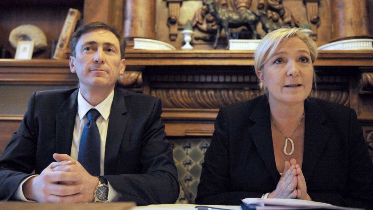 French far-right Front National (FN) party's candidate for the European elections for the regions Auvergne, Center and Limousin, Bernard Monot (L), and FN party's president Marine Le Pen (R) give a press conference ahead of the March 2014 mayoral elections in France and the May 2014 European elections on February 24, 2014 in Chartres, center France. AFP PHOTO / JEAN-FRANCOIS MONIER JEAN-FRANCOIS MONIER / AFP
