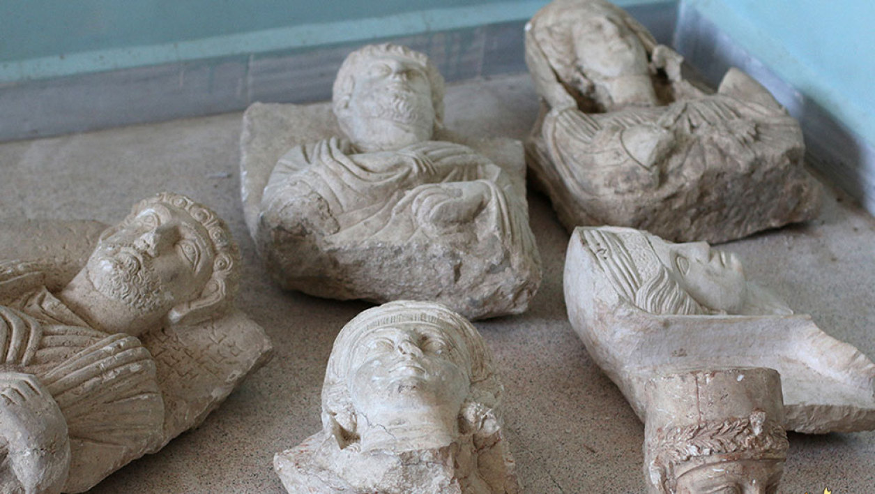 An image made available by propaganda Islamist media outlet Welayat Halab on July 2, 2015 allegedly shows ancient artifacts smuggled from the Syrian city of Palmyra, a 2,000-year-old metropolis and an Unesco world heritage site located 215 kilometres northeast of Damascus, before they were destroyed by Islamic State (IS) group fighters in the town of Manbij, northeast of Syria's embattled northern town of Aleppo.