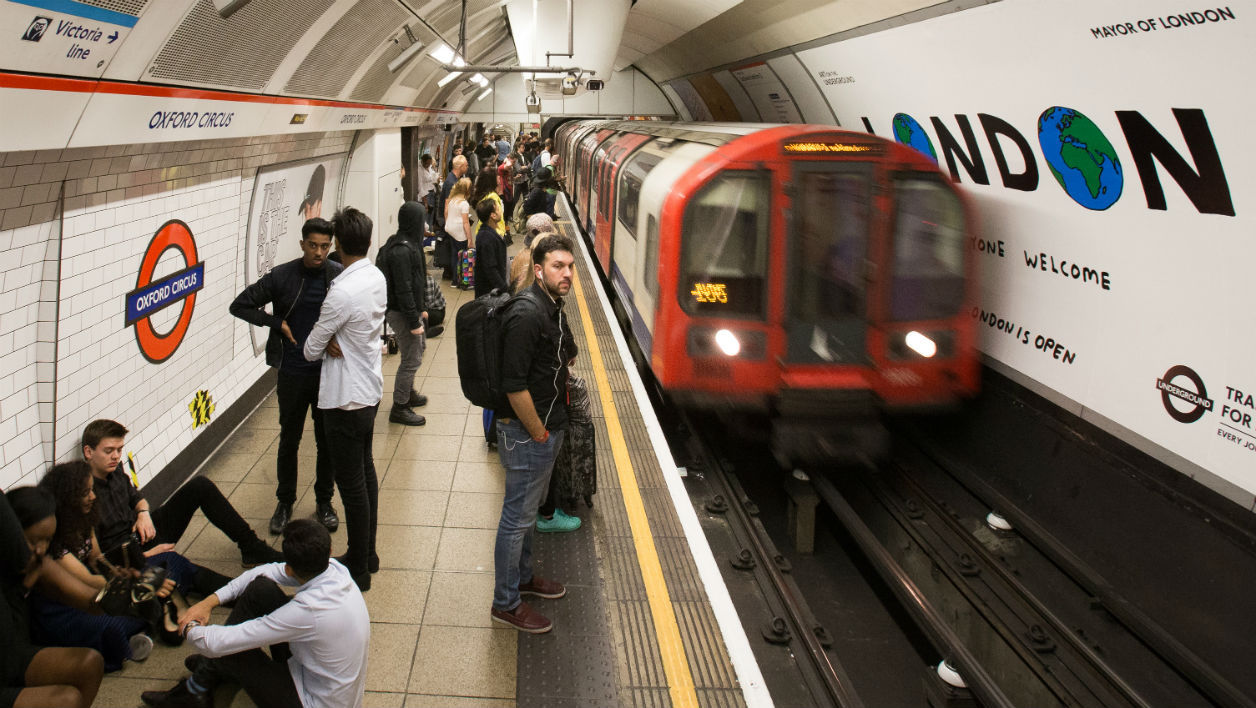 A London Underground train arrives at Oxford Circus station in central London on August 20, 2016, following the launch of the 24 hour night tube service. DANIEL LEAL-OLIVAS / AFP