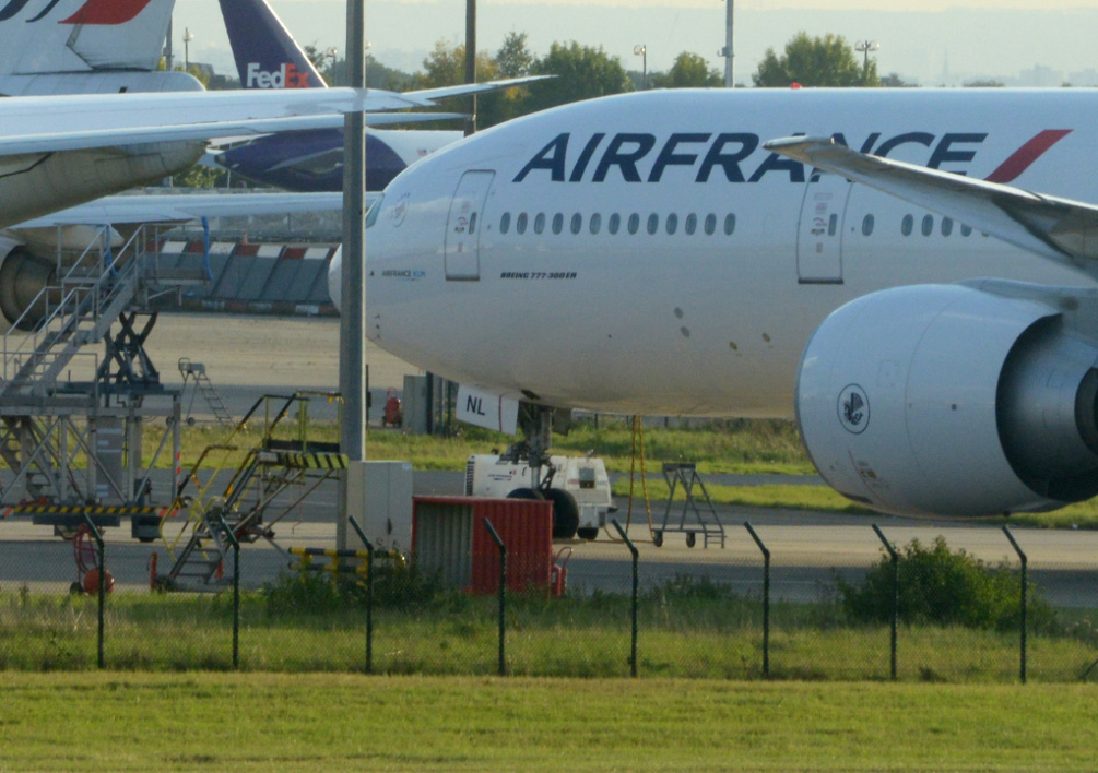 FRANCE, Paris : This picture taken on September 15, 2012 shows planes parked on the tarmac of Roissy Charles de Gaulle's airport, during the first day of the French company Air France pilots' strike. Stranded passengers voiced outrage on September 15 as French flag carrier Air France scrapped half its flights due to a pilots' strike in protest at company plans to expand its low-cost subsidiary Transavia. AFP PHOTO / DOMINIQUE FAGET