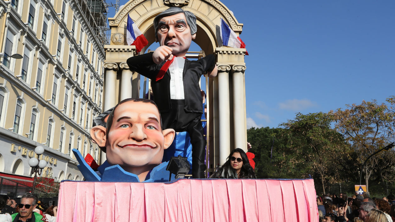 A float depicting French presidential election candidate for the right-wing Les Republicains (LR) party Francois Fillon and French presidential election candidate for the left-wing French Socialist (PS) party Benoit Hamon parade in the streets of Nice for the 133rd edition of the Nice Carnival on February 19, 2017 in Nice, southeastern France.