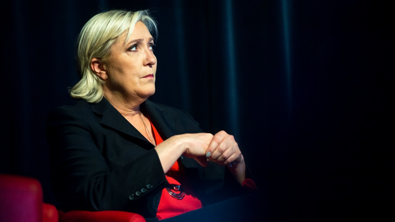 President of the French far-right Front National (FN) party, Marine Le Pen reacts during a campaign rally on June 8, 2017 in Calais in support of the local candidate for the upcoming parliamentary election (elections legislatives). Marine Le Pen is supporting her brother-in-law and advisor Philippe Olivier in Calais. PHILIPPE HUGUEN / AFP
