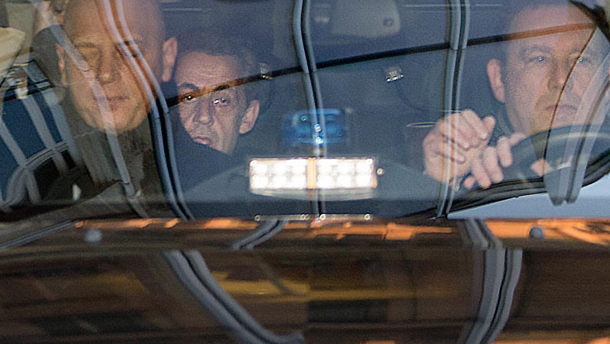 "Former French President Nicolas Sarkozy (C) arrives at the Pole financier (the financial section of Paris court house) in the French capital, on February 16, 2016, to be heard in the investigation of false invoices in the ""Bygmalion affair"", a corruption scandal centred on claims that his party paid some of his campaign expenses in 2012 to get around strict spending limits."