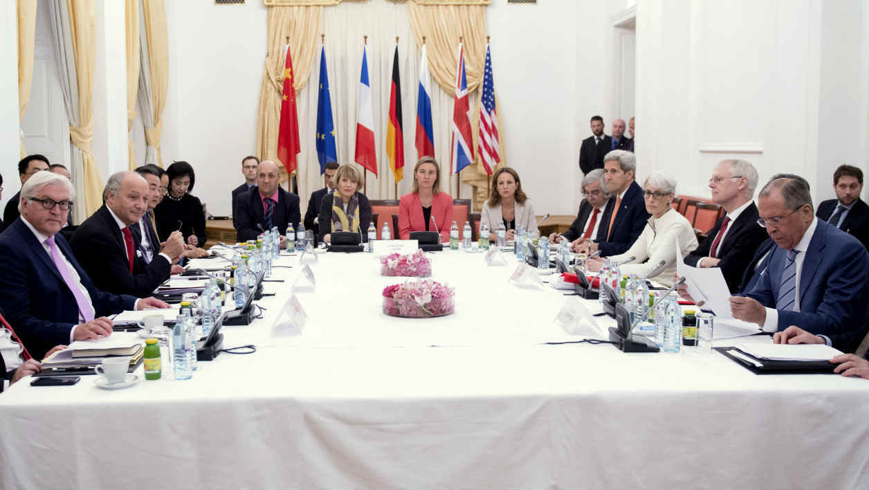 German Foreign Minister Frank-Walter Steinmeier (L), French Foreign Minister Laurent Fabius (2nd L), Chinese Foreign Minister Wang Yi (3rd L), European Union foreign policy chief Federica Mogherini (Centre in red), U.S. Secretary of State John Kerry (4th R) and Russian Foreign Minister Sergei Lavrov (R) meet at a hotel in Vienna July 13, 2015. Iran and six world powers were close to clinching an historic pact on Monday that would bring Iran sanctions relief in exchange for curbs on its nuclear programme, but an Iranian negotiator said he could not guarantee a deal was imminent. AFP PHOTO/ JOE KLAMAR