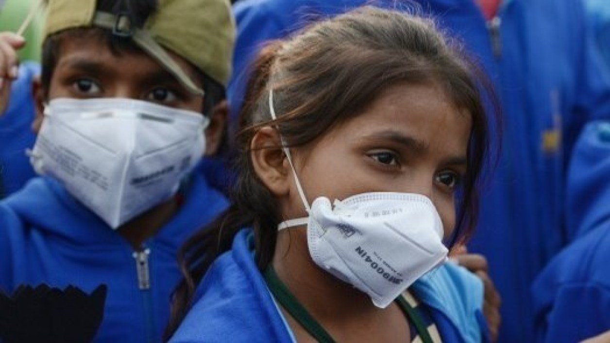"Indian children wearing air pollution masks attend a demonstration to spread awareness of the problem of air pollution on Children's Day in New Delhi on November 14, 2017. Angry parents accused Delhi authorities on November 13 of ""playing with children's health"" as schools reopened despite a fresh surge in pollution to emergency levels. Doctors declared a public health emergency last week when choking smog descended on the capital and elsewhere in northern India, prompting authorities to close schools, ban construction and bar trucks from entering the city.  MONEY SHARMA / AFP"
