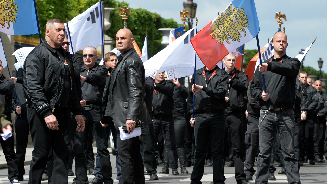 """Members of the """"Troisieme voie"""" (Third Way) nationalist group and their leader Serge Ayoub (2nd L), aka Batskin, take part on May 12, 2013 in Paris in a demonstration called by French nationalist and royalist group """"Action Francaise"""" gathering several far right movements to commemorate Joan of Arc. AFP PHOTO / MIGUEL MEDINA MIGUEL MEDINA / AFP"""