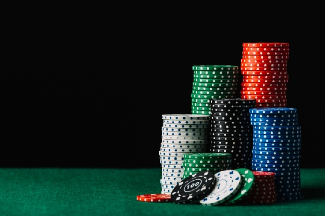 close-up-casino-chips-stack-green-poker-table_23-2147937911.jpg