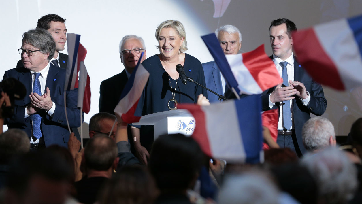 French presidential election candidate for the far-right Front National (FN) party Marine Le Pen smiles after delivering a speech during a campaign meeting at the Palais des Congres in Ajaccio on the French Mediterranean island of Corsica, on April 8, 2017.