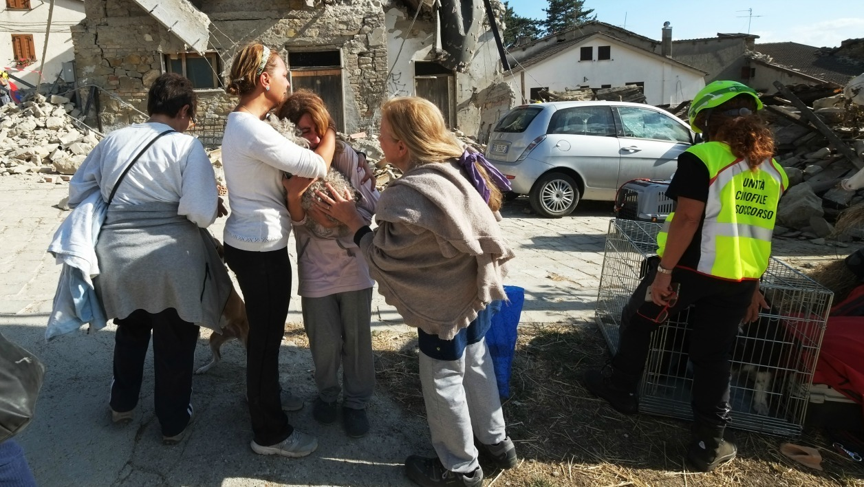 Women cry in front of damaged houses in a street in the central Italian village of Illica, near Accumoli, on August 24, 2016 after a powerful earthquake rocked central Italy. A powerful pre-dawn earthquake devastated mountain villages in central Italy on August 24, 2016, leaving at least 73 people dead, dozens more injured or trapped under the rubble and thousands temporarily homeless.