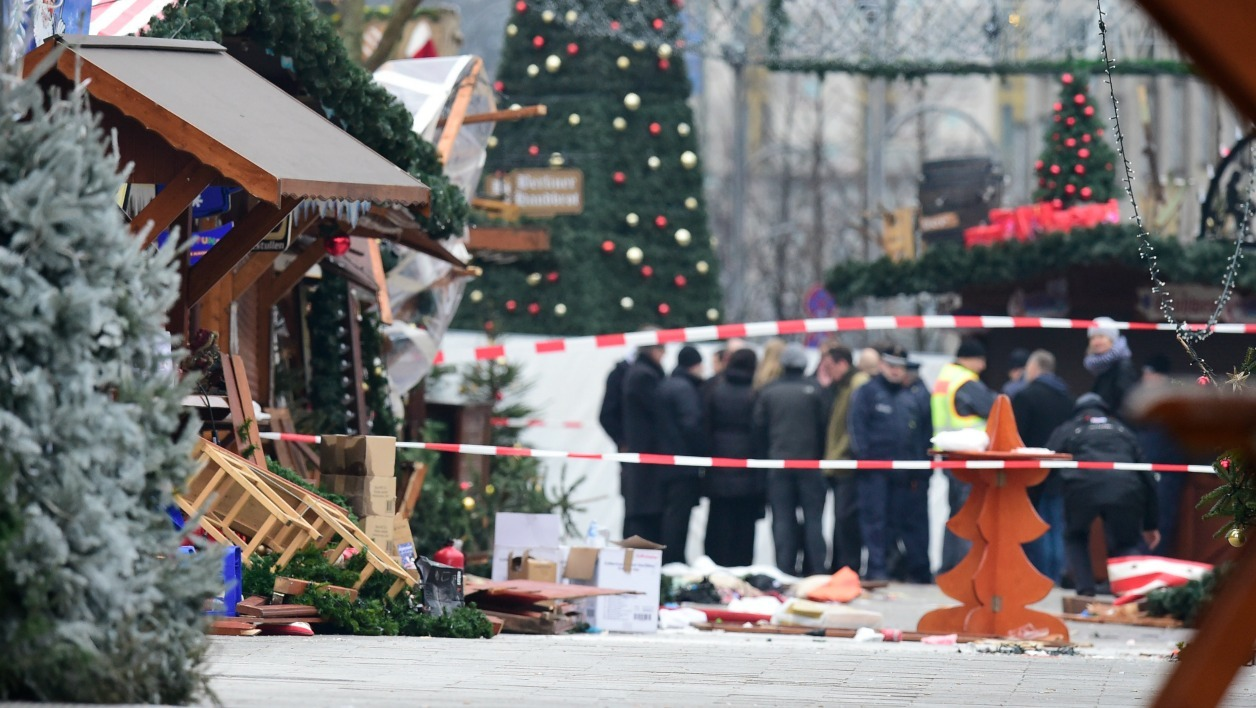 "A view of the Christmas market near the Kaiser-Wilhelm-Gedaechtniskirche (Kaiser Wilhelm Memorial Church), the day after a terror attack, in central Berlin, on December 20, 2016. German police said they were treating as ""a probable terrorist attack"" the killing of 12 people when the speeding lorry cut a bloody swath through the packed Berlin Christmas market. Tobias SCHWARZ / AFP"