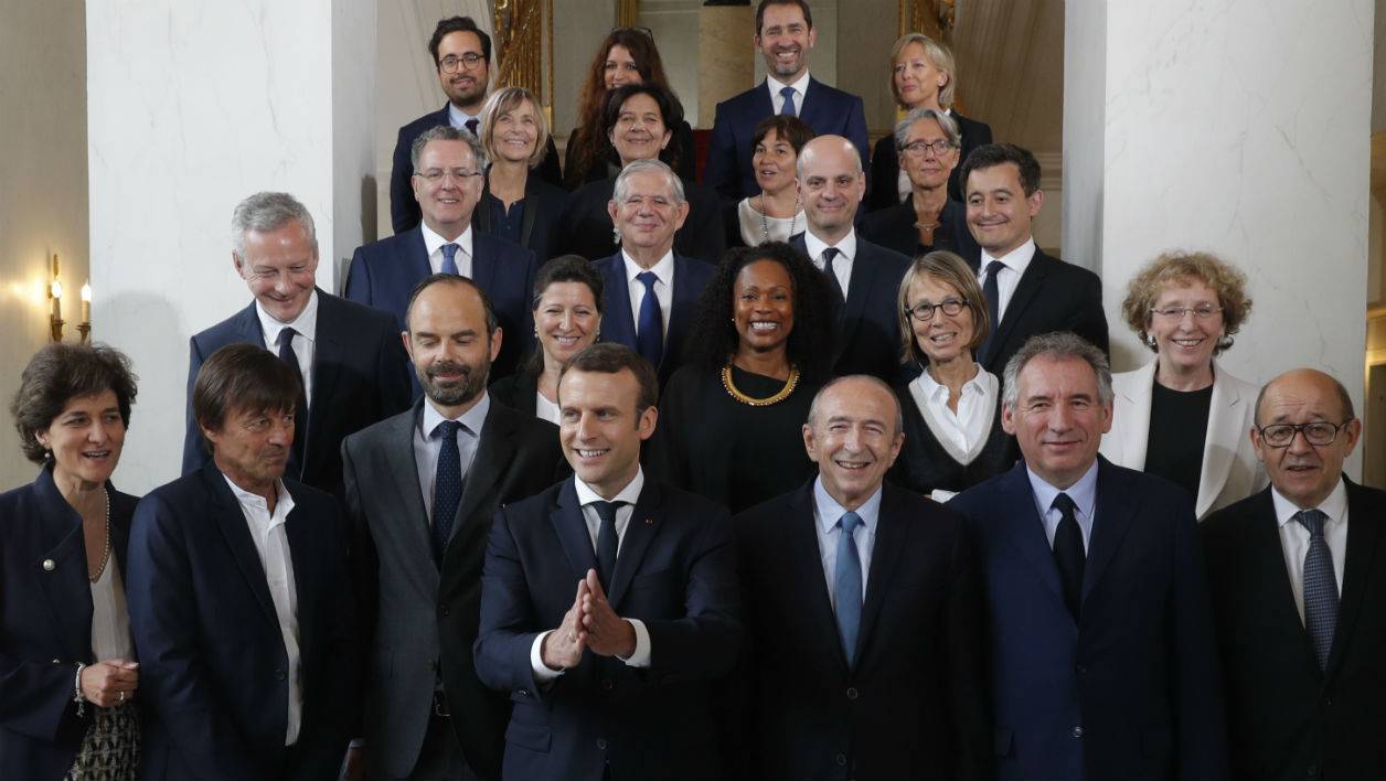 French President Emmanuel Macron (4-L) and Prime Minister Edouard Philippe (3-L) pose for a family photo after the first cabinet meeting at the Elysee Palace in Paris, France, May 18, 2017. French President Emmanuel Macron appointed his first cabinet mixing Socialists, centrists and rightwingers with newcomers to politics as he pressed ahead with plans to create a broad governing coalition. PHILIPPE WOJAZER / POOL / AFP