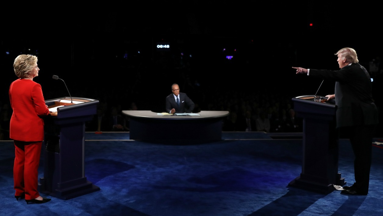 HEMPSTEAD, NY - SEPTEMBER 26: Republican presidential nominee Donald Trump (R) debates Democratic presidential nominee Hillary Clinton as Moderator Lester Holt (C) looks on during the Presidential Debate at Hofstra University on September 26, 2016 in Hempstead, New York.