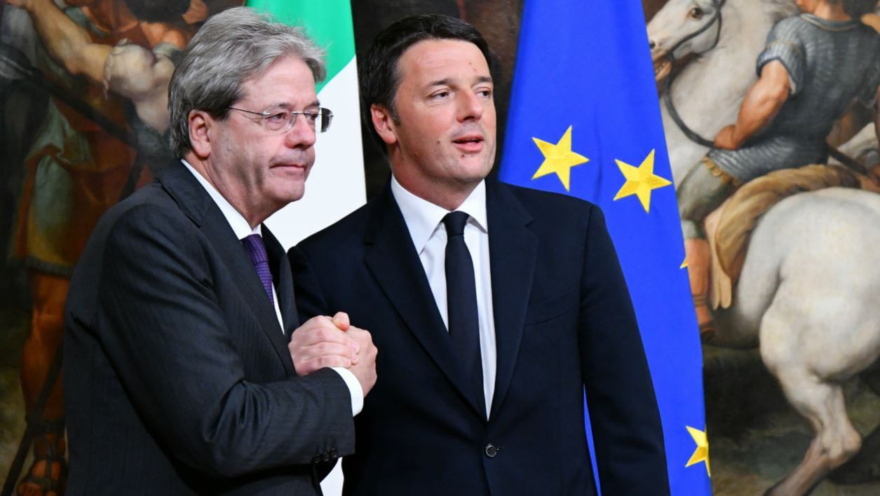In this file photo taken on December 12, 2016 Former Prime Minister Matteo Renzi (R) and Italy's newly appointed Prime Minister Paolo Gentiloni pose during a swearing in ceremony at the Palazzo Chigi in Rome.