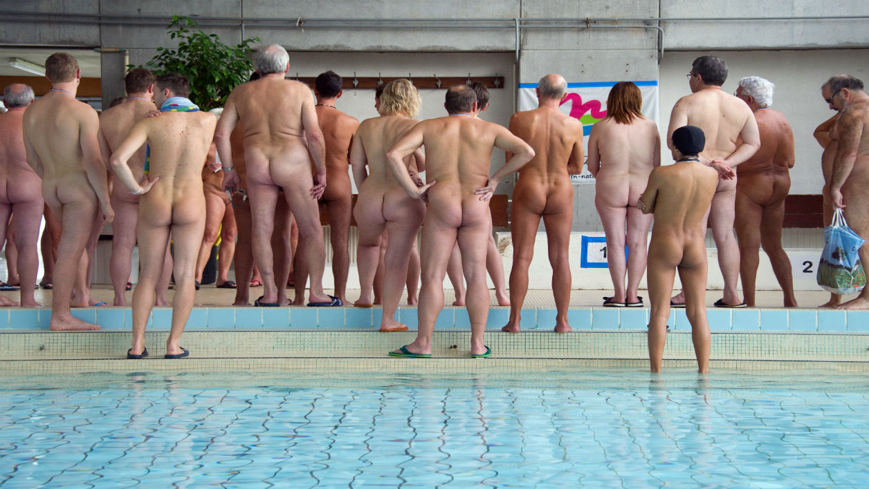 Competitors wait for the podium ceremony during a naturist swimming championship on October 25, 2014 in Mulhouse, eastern France. AFP PHOTO / SEBASTIEN BOZON SEBASTIEN BOZON / AFP