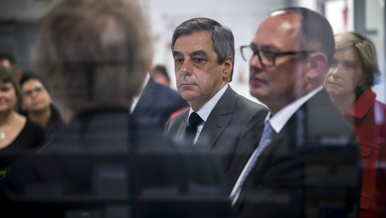 French presidential election candidate for the right-wing Les Republicains (LR) party Francois Fillon (C) takes part in a visit focusing on the employment of persons with disabilities at the Copiver compagny on April 10, 2017 in Le Plessis-Robinson near Paris.  Lionel BONAVENTURE / POOL / AFP